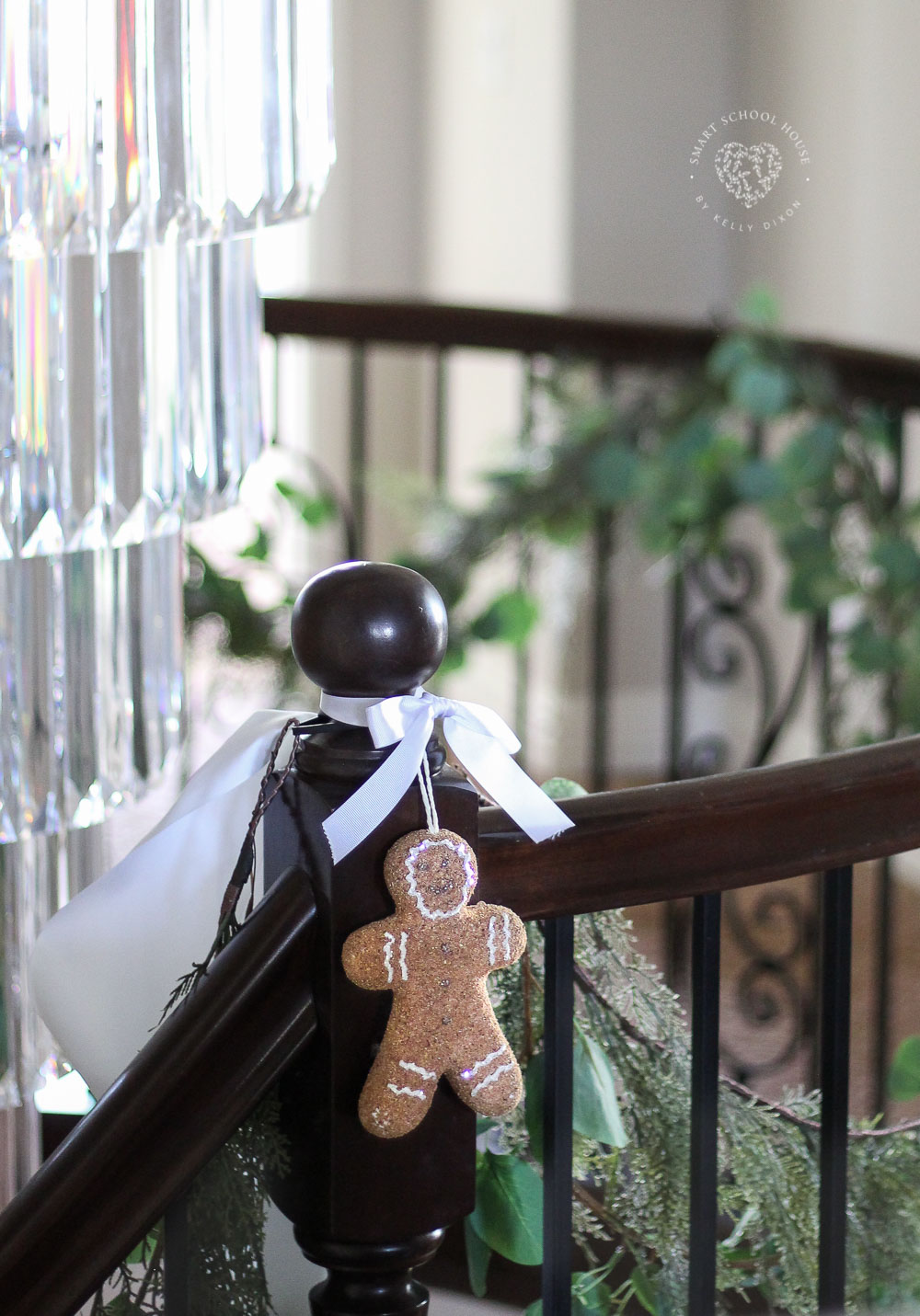 Eucalyptus Garland for Christmas tied with white ribbons and a gingerbread man. Simple and beautiful garland idea for Christmas. #ChristmasGarland #EucalyptusGarland