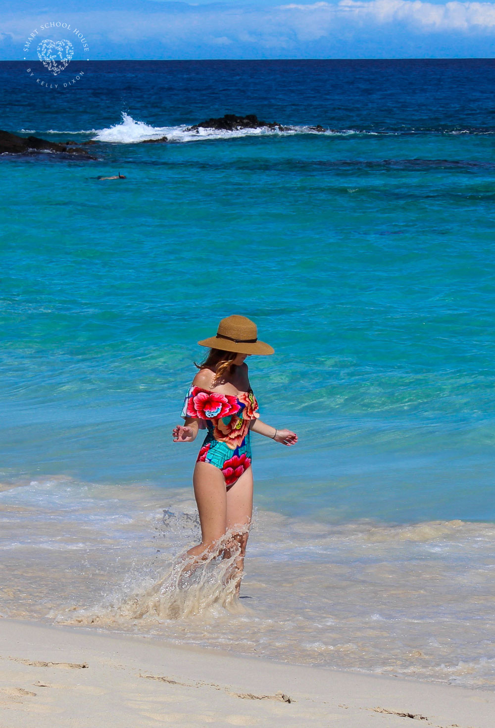 Floral one pice swimsuit bursting with color in Makalawena Beach, Big Island Hawaii