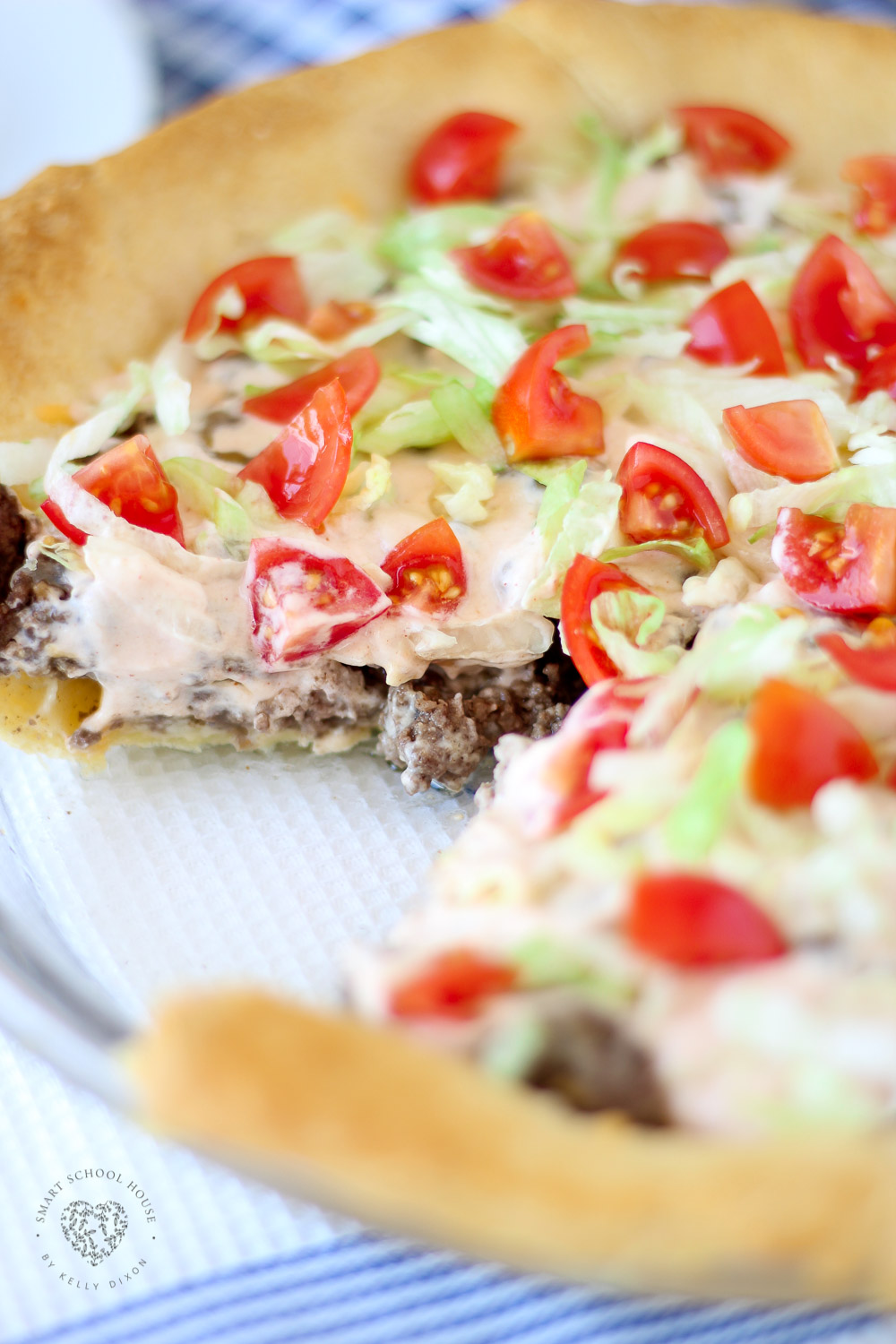 Taco Pie. An easy recipe for dinner! Fluffy dough baked in a pie dish then loaded with beef and cheese. Our secret sauce makes this taco pie over the top. #TacoPie #DinnerIdeas #EasyDinner