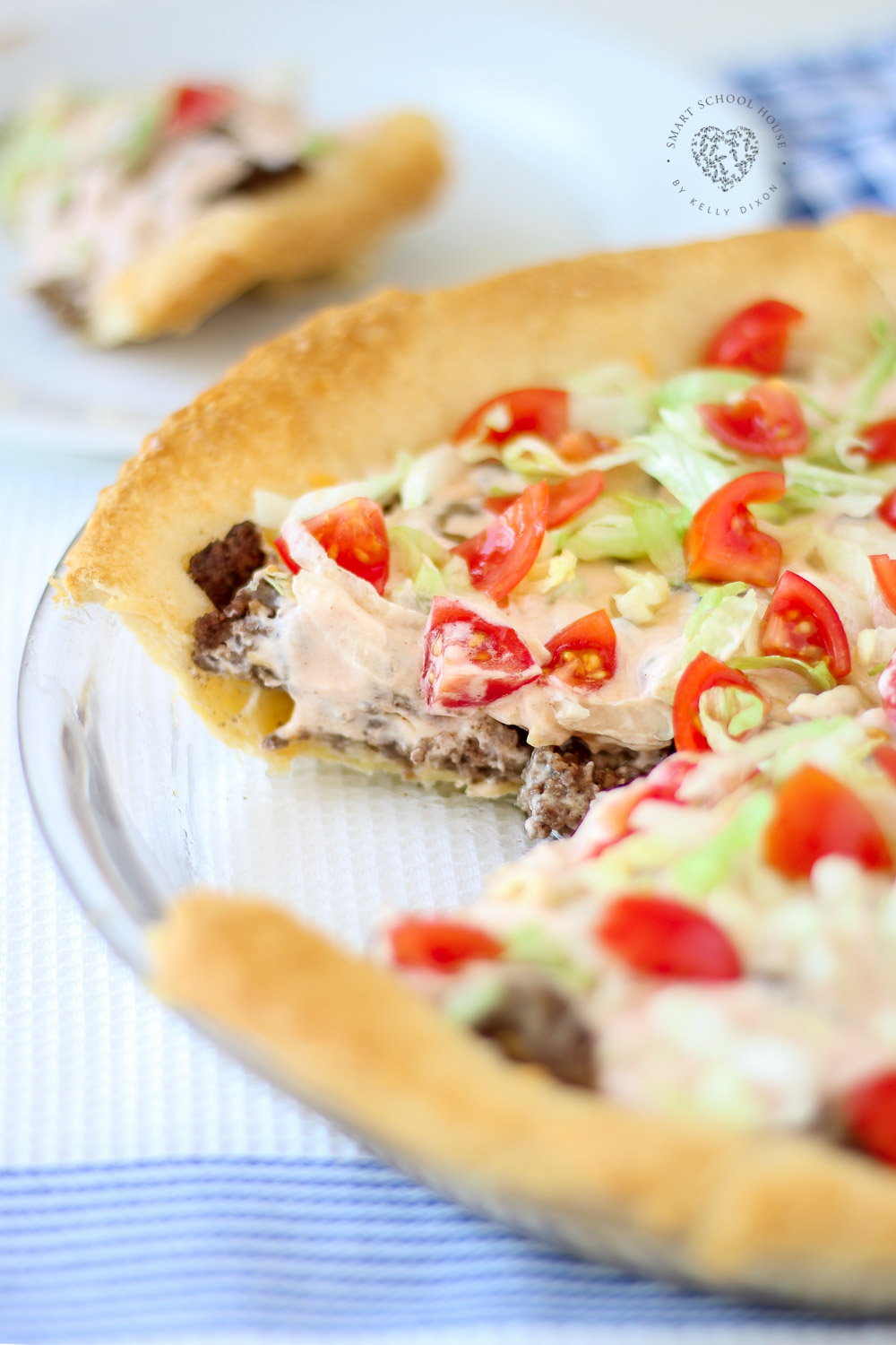 Easy Taco Pie Recipe! An easy recipe for dinner! Fluffy dough baked in a pie dish then loaded with beef, cheese, and more. #TacoPie #DinnerIdeas #EasyDinner