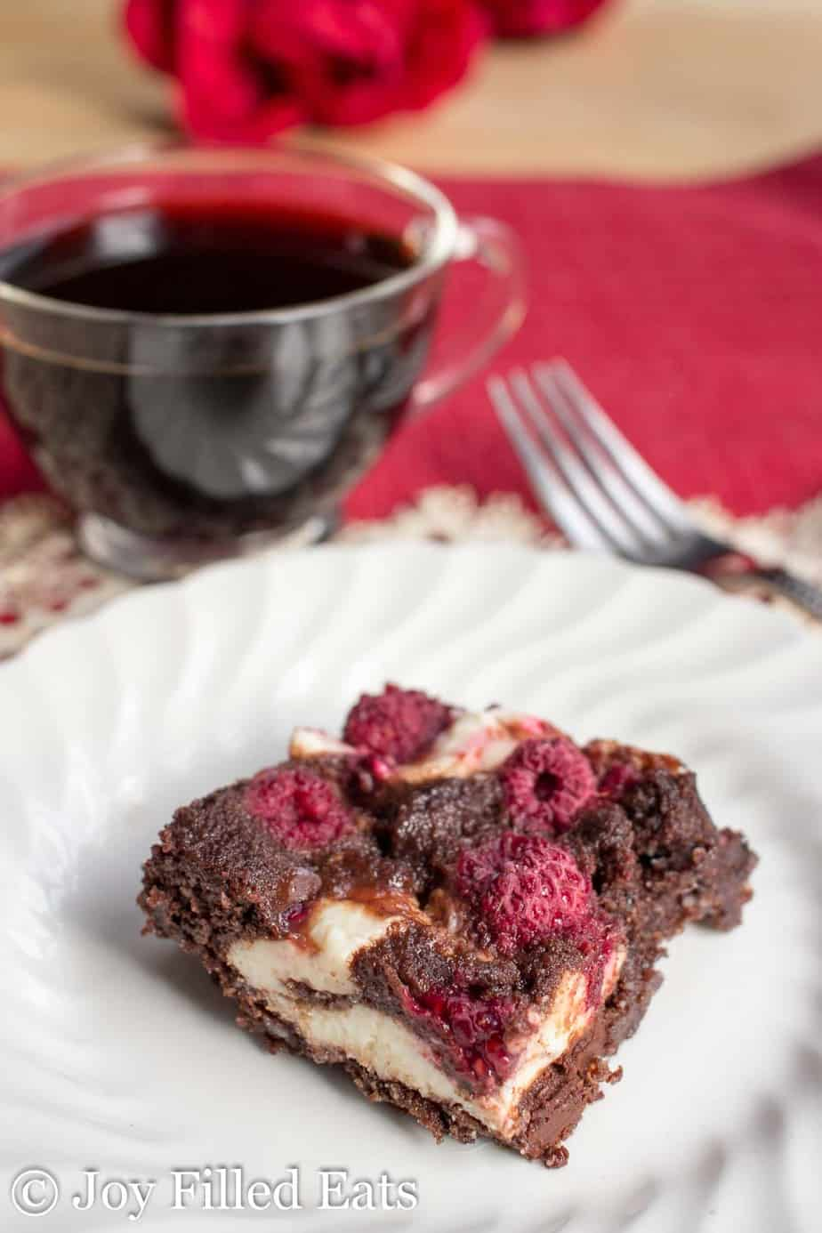 Raspberry Cheesecake Brownies - Keto Low Carb. Dark Chocolate Raspberry Cheesecake Brownies are the perfect dessert or grab and go snack. With the flavors of chocolate, raspberries, and cheesecake they will be your new favorite treat. They are low carb, keto, grain-free, gluten-free, and sugar-free.