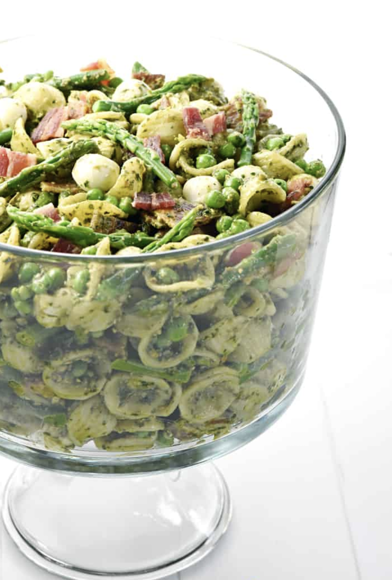 Pesto Pasta Salad ~ studded with bright green asparagus, sweet peas, decadent bacon, and fresh pearls of mozzarella, this pasta salad is a flavorful side dish or light dinner, perfect for spring and summer celebrations!