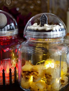 Halloween Snow Globes on top of glass jars. Spooky and mysterious!
