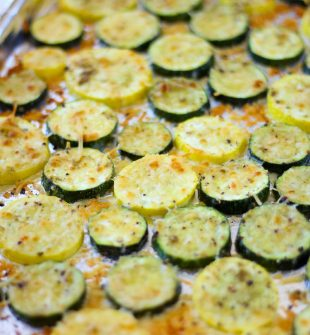 Baked Parmesan Zucchini is one of those versatile side dishes that you can make alongside several dinners. Tender zucchini rounds baked to absolute perfection in just 13 minutes. It's healthy, nutritious and completely addictive.