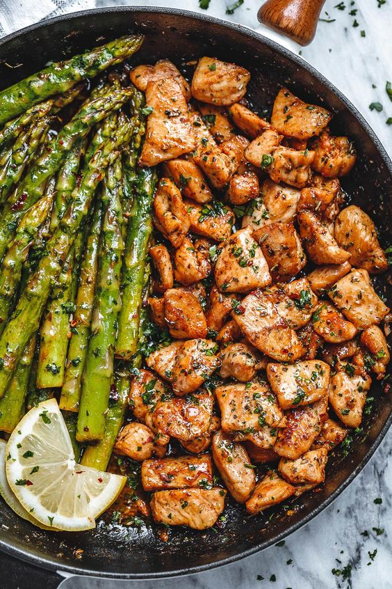 Garlic Butter Chicken Bites and Asparagus – So much flavor and so easy to throw together, this chicken and asparagus recipe is a winner for dinnertime! Chicken bites are so juicy, tender, and delicious you'll eat them hot right off the pan!