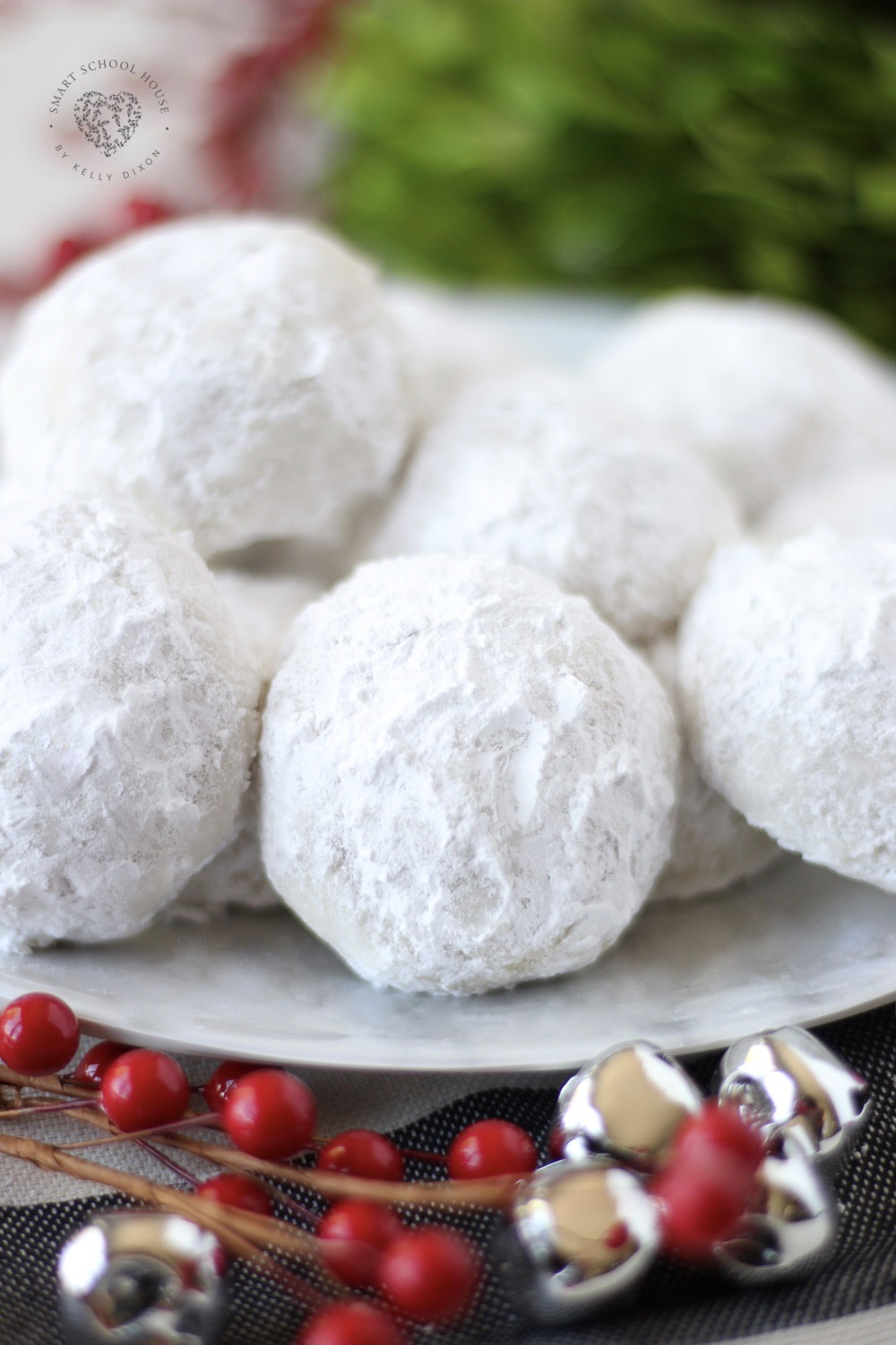 Our Snowball Cookies are a Christmas favorite! They have a buttery vanilla flavor surrounded by soft and snowy powdered sugar. These melt in your mouth cookies are a beautiful addition to your holiday cookie plates and dessert tables.