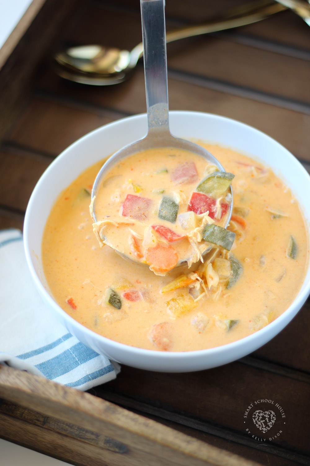This creamy crock pot curry soup is a healthy dinner recipe that's perfect for fall and winter. Crock pot curry is one of the easiest meals to make and is so tasty. Your family will LOVE it! #chicken#chickencurry#slowcooker#crockpotrecipes#chickenrecipes#thaicurry