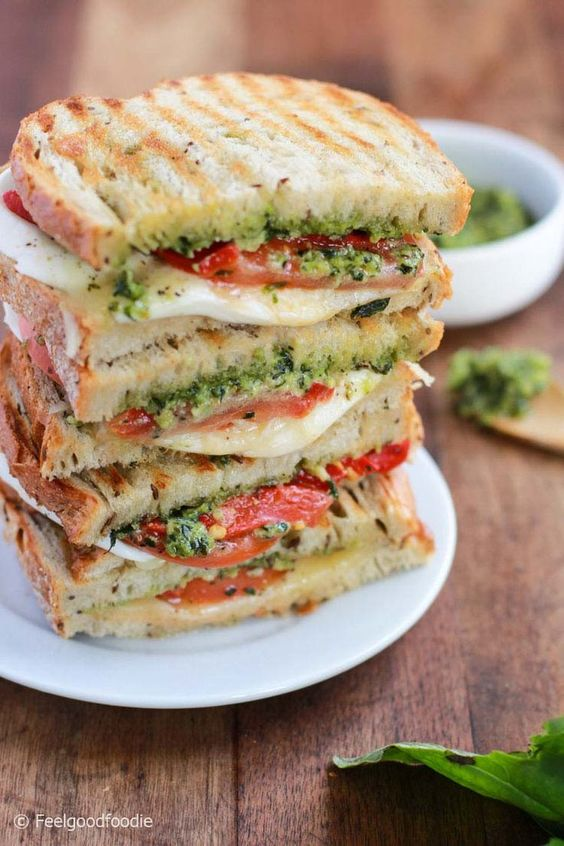 This Grilled Mozzarella Sandwich is made with fresh tomatoes and walnut pesto grilled with sourdough bread. It's easy to assemble and bursting with flavor!
