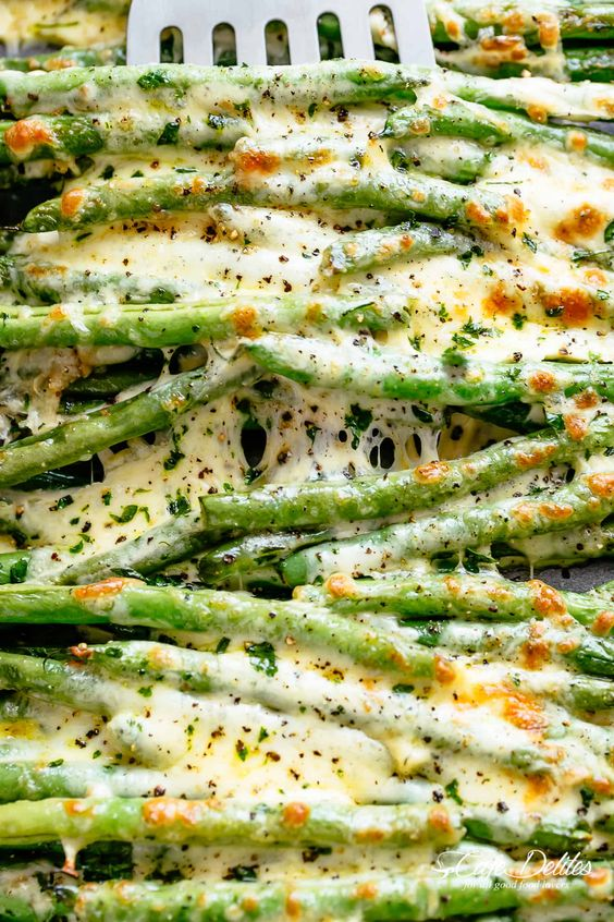 Cheesy Garlic Roasted Green Beans with mozzarella cheese is the best side dish to any meal! Low Carb, Keto AND the perfect way to get your veggies in! Tastes so amazing that the whole family gets behind this one.