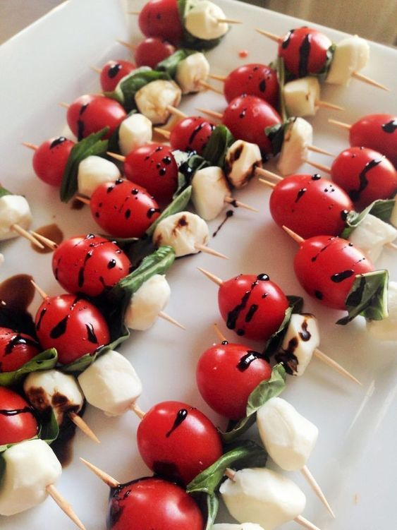 Caprese skewers with the bright flavors of fresh mozzarella and basil.