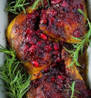 Beautifully baked chicken glazed with a delicious cranberry marinade. Cranberry Chicken is a gorgeous dinner for your Christmas table!
