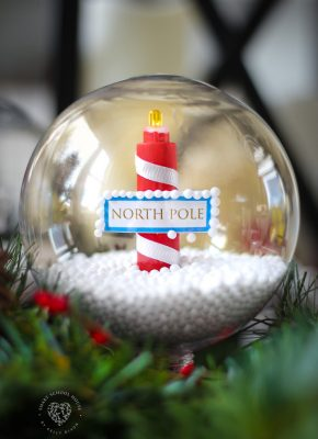 DIY Glowing Solar North Pole Snow Globe Made With a Plastic Ornament for Christmas