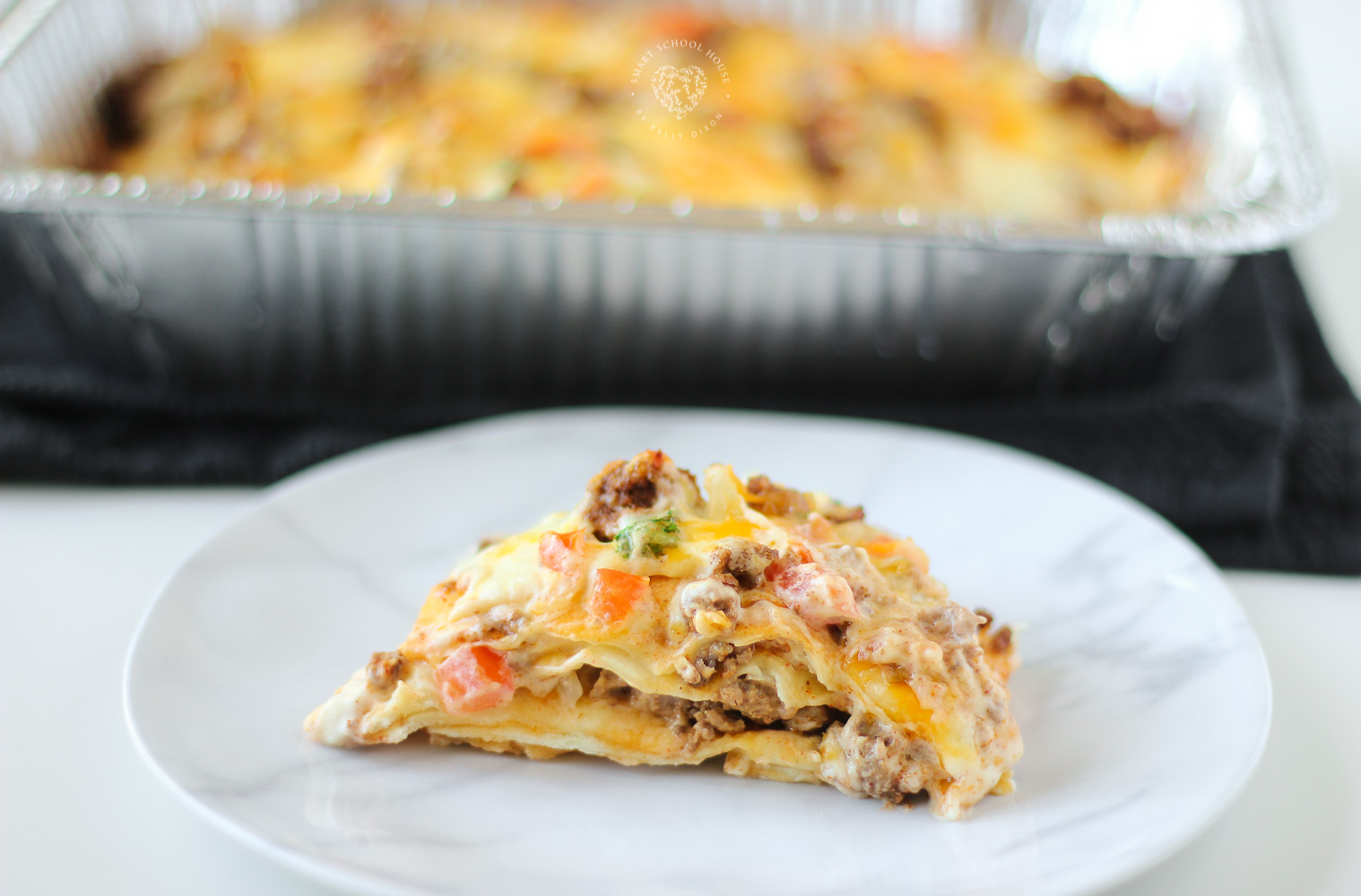 Taco Lasagna is made with soft flour tortillas, seasoned taco ground beef, and pico de gallo. But the cheese is really what makes this Taco Lasagna OVER THE TOP!