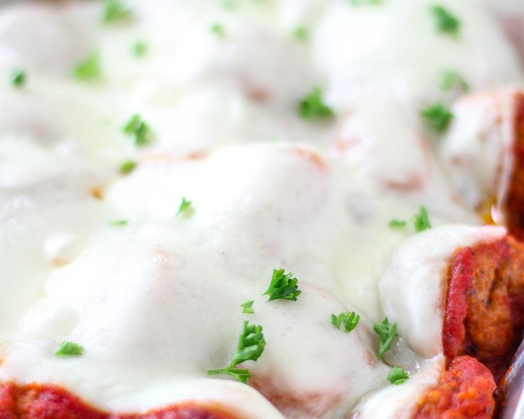 Meatball Sub Casserole - Layers of meatballs, creamy mozzarella cheese, and a special cheese sauce all on top of garlic toast. This casserole a perfect weeknight dinner.