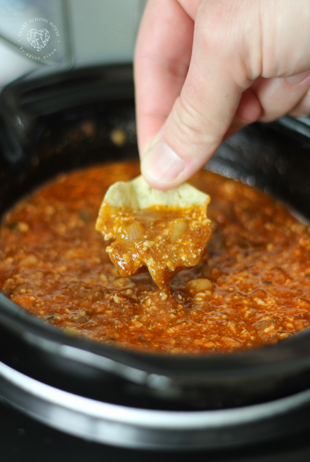 This quick and easy homemade Crock Pot Chili Dip is loaded with queso fresco goodness, chili, and salsa.