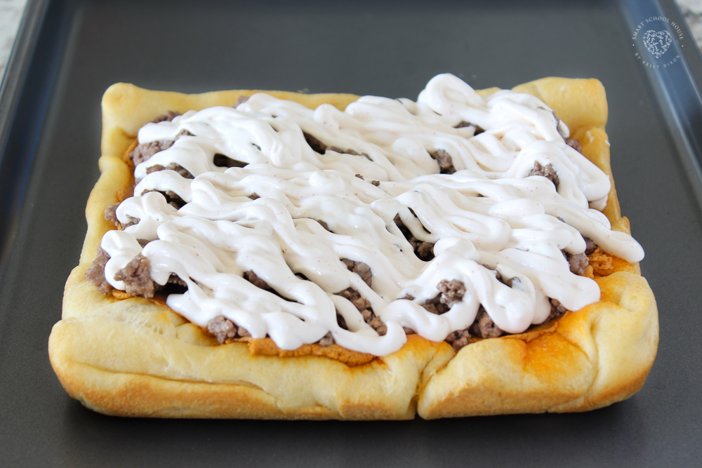 Sour cream drizzle on taco pizza