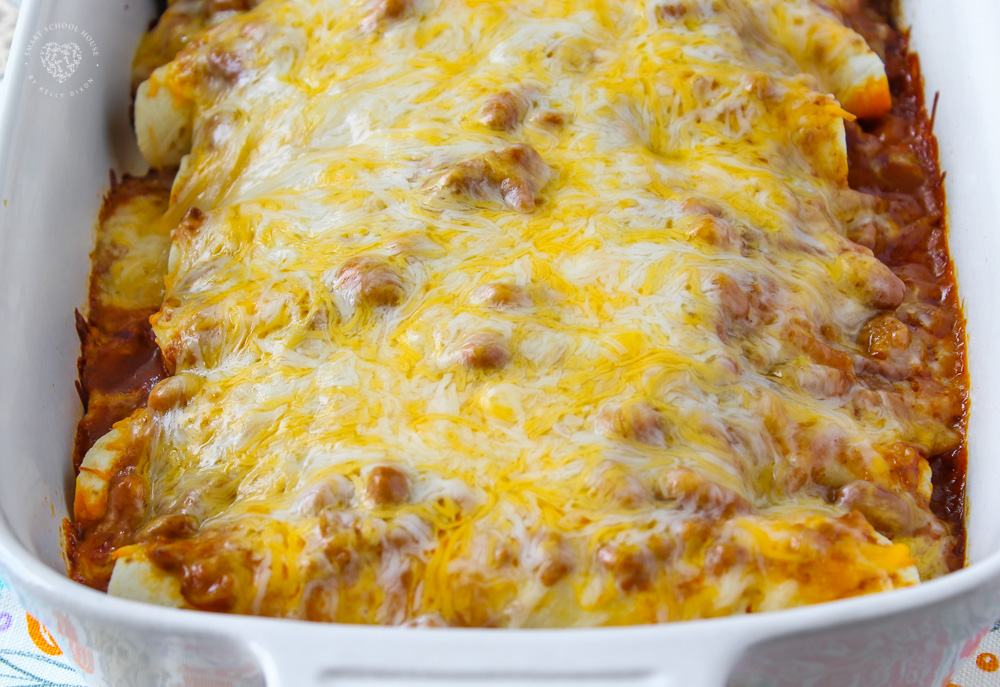 This Cheesy Chili Dog Casserole is pure comfort food. Hot dogs, chili, and cheddar cheese combined to make an easy and delicious meal. #hotdog #casserolerecipes