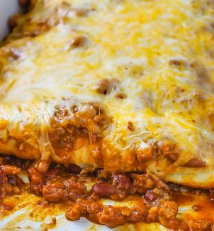 Chili Dog Casserole - 4 Ingredient easy, cheesy dish with hot dogs, chili, and beans. A quick and easy dinner recipe to make over and over again!