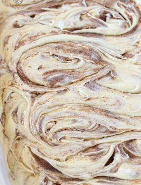 Cinnamon Roll Cake - A cinnamon roll turned into an gooey gooey cake with buttery cinnamon swirls!