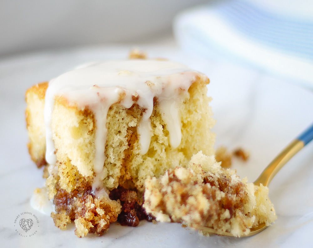 Cinnamon Roll Cake - Easy No Fuss Recipe Using Box Cake! Buttery cinnamon swirls and a sweet glaze.