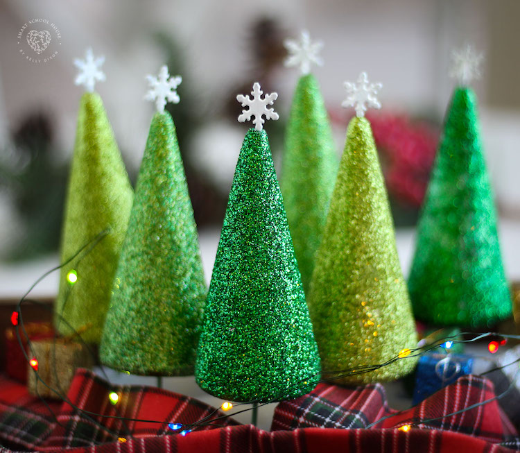 Beautiful and Sparkly DIY Styrofoam Christmas Trees with Little Wooden Tree Trunks.