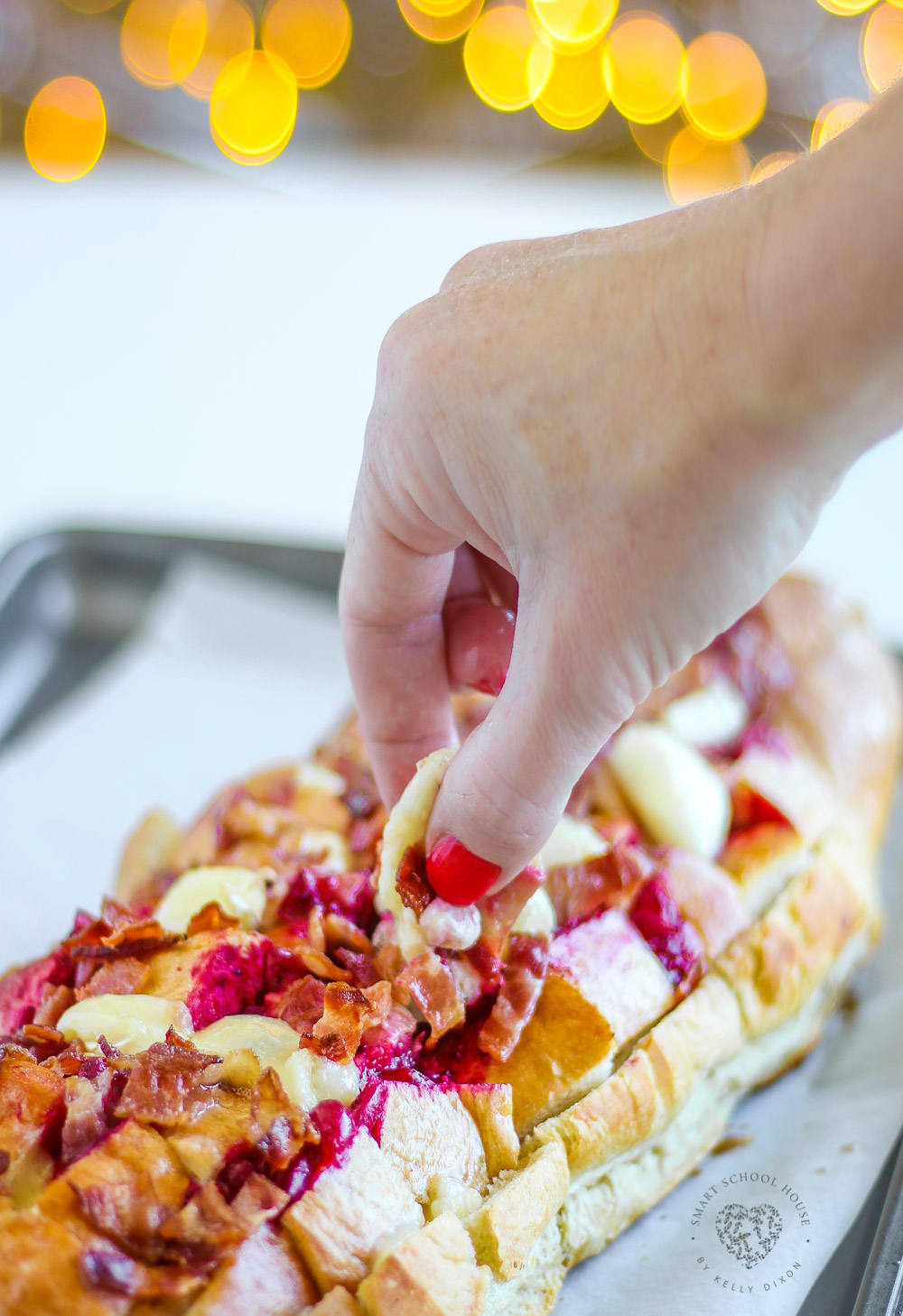 Whether planning recipes for holiday leftovers or planning appetizers for holiday get togethers, this Cheesy Bacon and Cranberry Pull Apart Bread recipe is a MUST have! It's cheesy, buttery, filled with bacon, and of course, festive cranberry sauce.