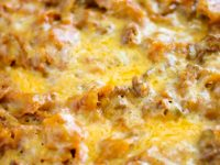 Tortilla Chip Enchiladas are made with beef or chicken, enchilada sauce, spices, cheese, and crispy tortilla chips.