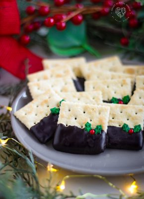 Christmas Crackers use your favorite old fashioned saltine cracker, dipped in chocolate, and adorned with holly sprinkles!