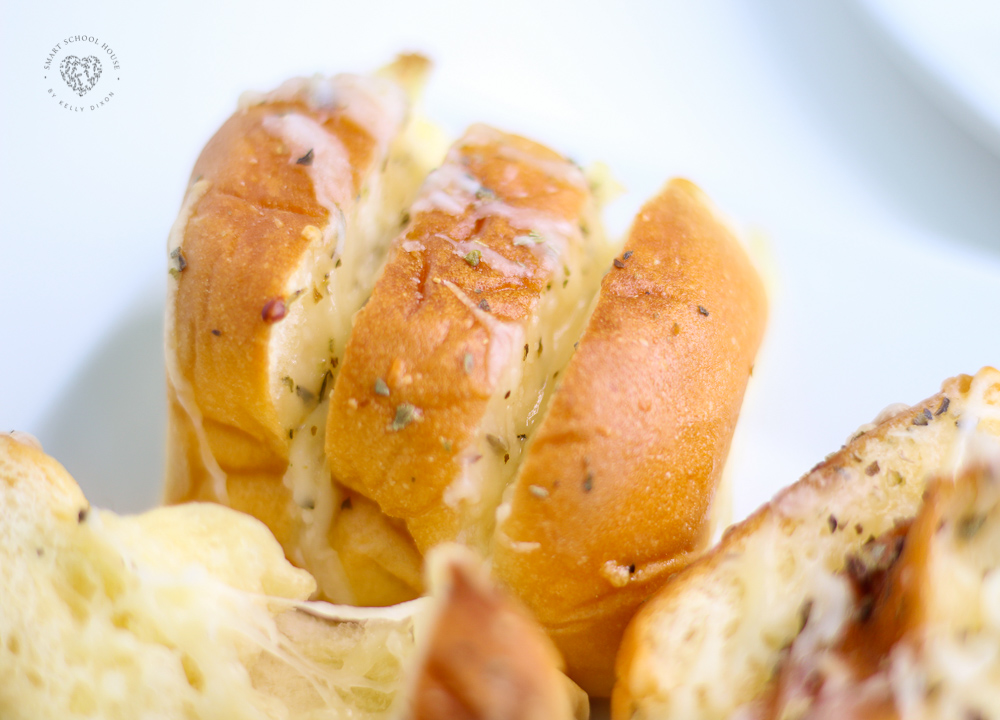 """The first time I made this Cheesy Hawaiian Garlic Bread, I said, """"Why haven't I thought of this before?!"""" These garlic rolls are soft, buttery, and cheesy with a hint of sweetness."""