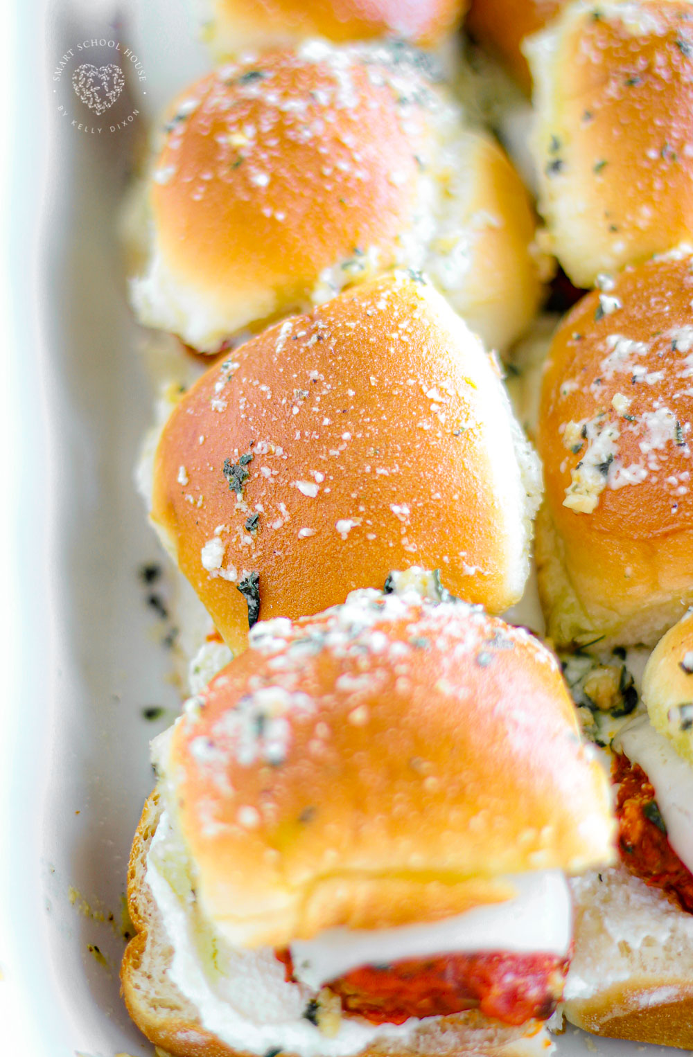 Cheesy Meatball Sub Sliders - These cheesy, garlic butter mini meatball sub sliders are perfect for parties, snacks and weeknight meals + holidays! Easily homemade and delicious recipe!