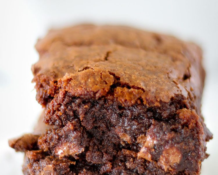 Thick homemade brownies with crispy edges, chewy middles, and rich chocolate flavor.