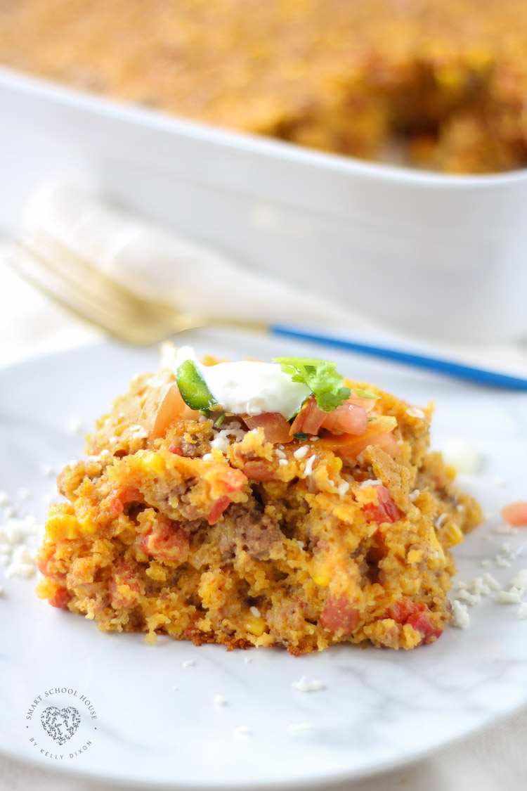 Cowboy Cornbread Casserole layers ground beef, beans, corn, cheese, seasonings, and cornbread batter into a hearty meal that everyone loves!