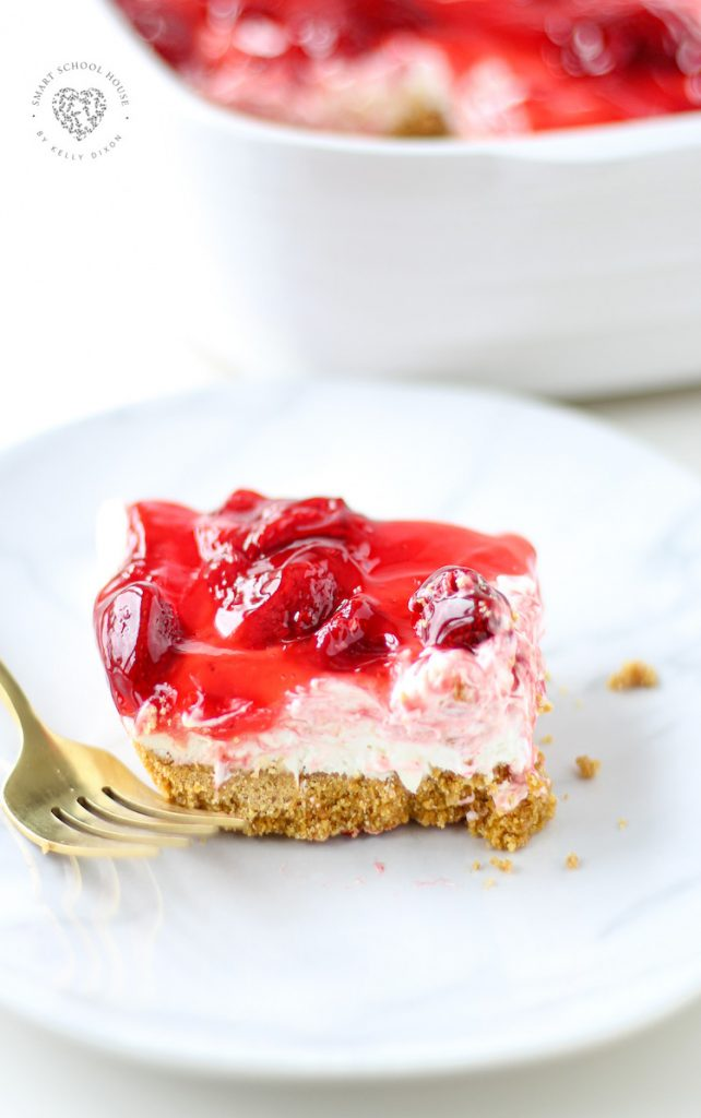 Easy Strawberry Cheesecake Bars, these irresistible squares are quick, easy and so delicious! Made with a graham cracker crust and strawberry filling. Easy and tasty bars.