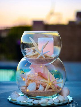 Stacked Fish Bowl with Seashells, Sand, and Starfish. Perfect for a coastal centerpiece, under the sea party, or beach decor!