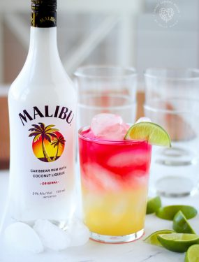 The Drink to Enjoy All Summer Long! Malibu Rum, pineapple Juice, and cranberry juice over ice with a slice of lime