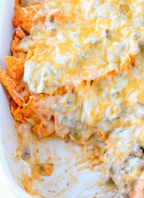 This Dorito casserole is layers of crushed Dorito chips, ground beef, and an ooey-gooey cheese sauce. It all gets baked together to melted cheese perfection.