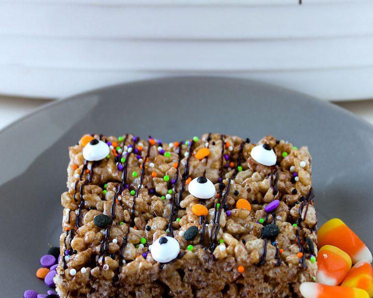 These delicious chocolate Halloween Cocoa Krispies Treats are drizzled with chocolatey goodness and sprinkled for Halloween!