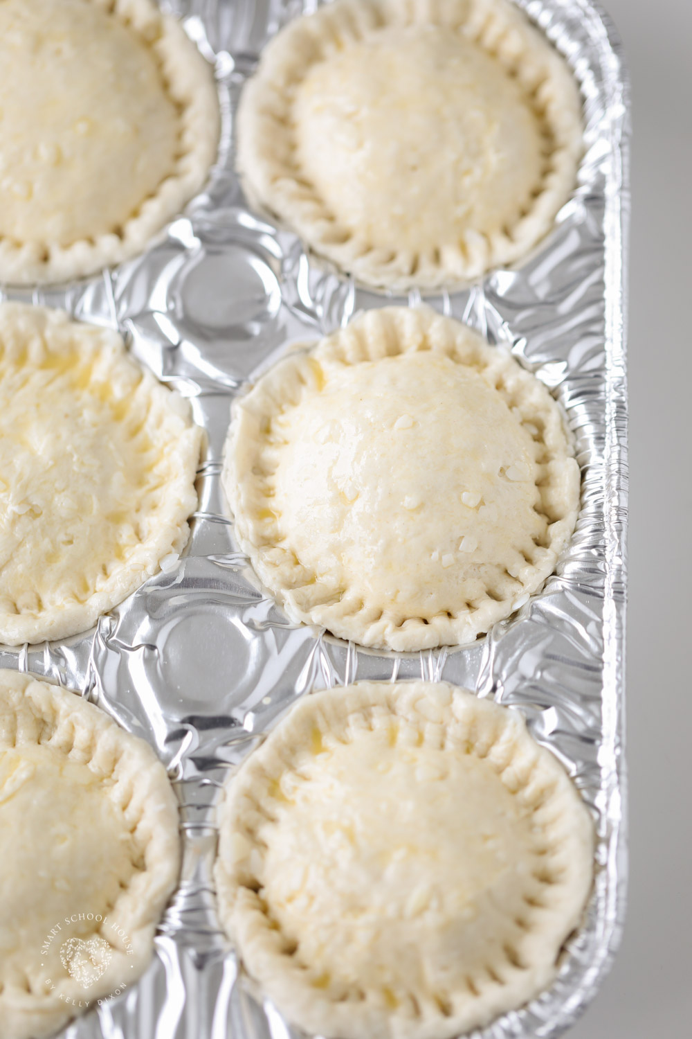 How to make pot pies with biscuits in a muffin tin