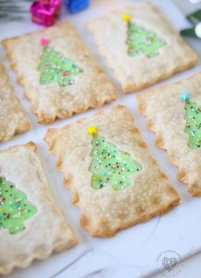My Christmas Tree Hand Pies are as adorable as it gets! These little handheld pies are filled with delicious cheesecake and surrounded with pie crust and adorned with sprinkles that look like Christmas lights. This holiday dessert idea is sure to get everyone's attention!